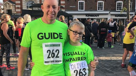 Visually impaired Hitchin Town Centre 5km Race runner Ollie Murphy with his dad and guide runner Joh
