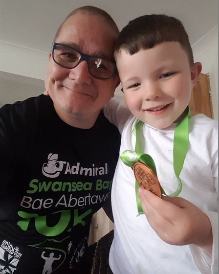 Paul Scanlon, pictured with grandson Anton after completing the Swansea 10k, will take on the Steven