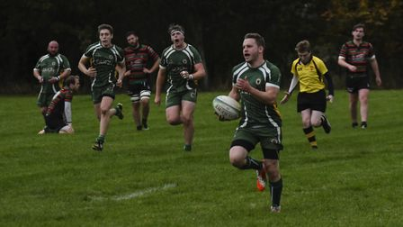Saffron Walden's Paul Marshall runs clear to score a try against Fullerians (pic Jamie Pluck)