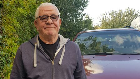 Vic Hobbs, 72, with his red Ssangyong Rexton 4x4. Picture: Jan Hobbs