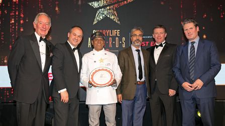 Biggles Lounge curry chef Nazim Uddin with his award, flanked by broadcast journalist Michael Buerk,