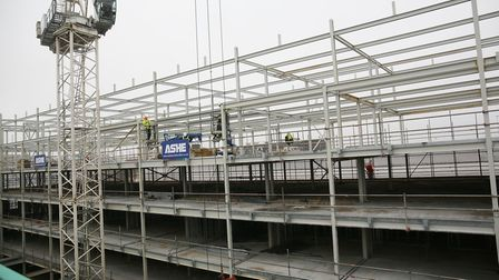 The final steel beam of the Park Place development is lifted into place. Picture: Danny Loo