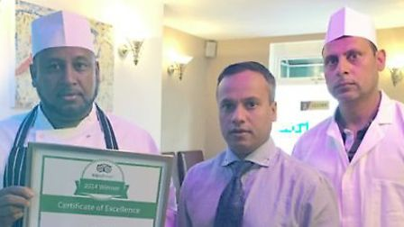 Hammad Khan and two of his team at the Raj Bengal in Biggleswade. Picture: Hammad Khan