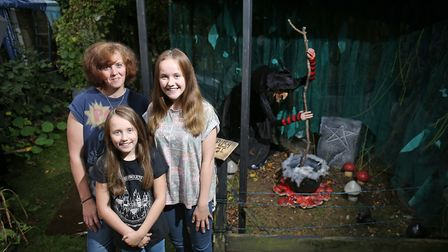 Kelly Morton, Chloe Barber, 13 and Rosie Morton, eight, with the Halloween display at the St Evenage
