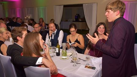 Magician Mitchell Kettlewell performing at one of the tables on the night. Picture: All Type Imagery