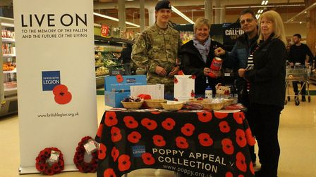 Army Cadet Steven Cooke, and volunteer Jill Cooke with two members of the public.at the Tesco store