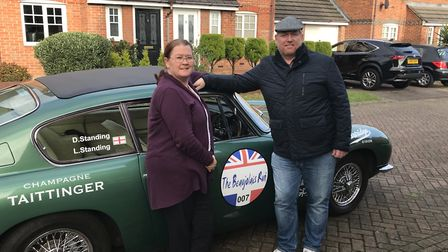 Darren and Lorraine Standing with their Aston Martin ahead of the Beaujolais Run. Picture: Darren St