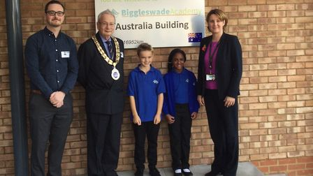 Parker Matheson and Samantha Date-Bah outside Biggleswade Academy's new classroom block with Biggles