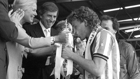 Coventry City captain Brian Kilcline kisses the FA Cup as the Duchess of Kent hands it over. Coventr