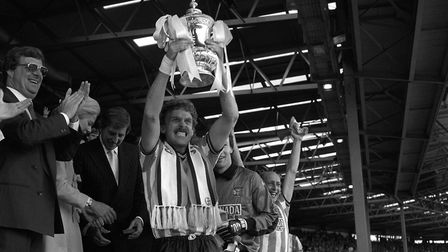 Coventry City captain Brian Kilcline lifts the FA Cup after his team's 3-2 victory
