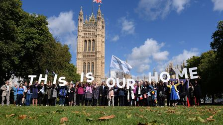 EU citizens holding up a banner after lobbying MPs to guarantee their post-Brexit rights at the Hous