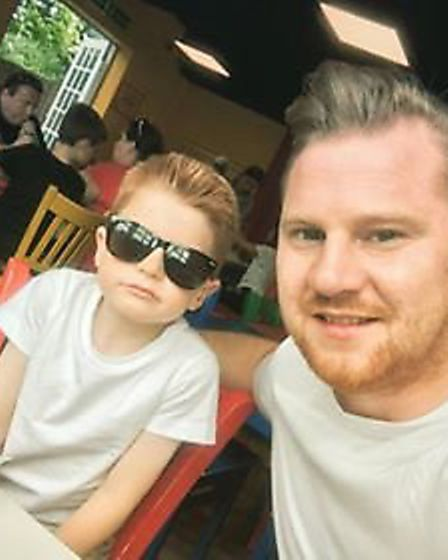 Christopher Davis with his seven-year-old son Jake