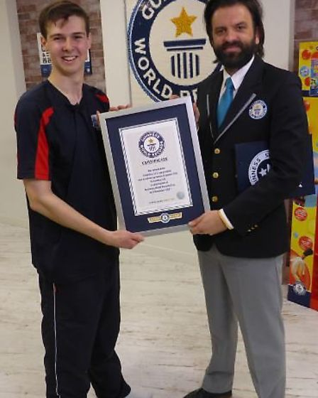 James Acraman receives confirmation of his new Guinness World Record from an official judge.