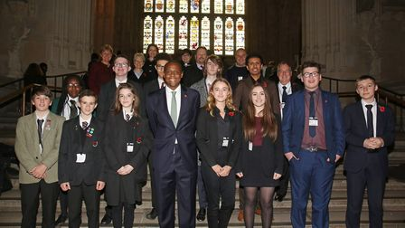 Hitchin and Harpenden MP Bim Afolami with the judges and the winning pairs of pupils from schools in