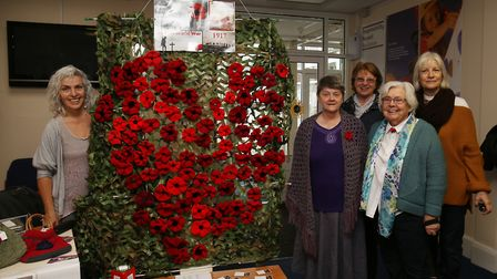 Some of the Hitchin Stitchin' members who contributed some poppies to the Remembrance Sunday display