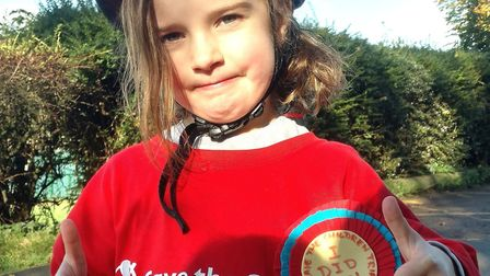 Erica crossed the finish line, raising more than £1,600 for charity. Picture: Kat Buckingham.