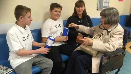 Chatting to patients and visitors, the boys showed a knack of communicating with the public. Picture