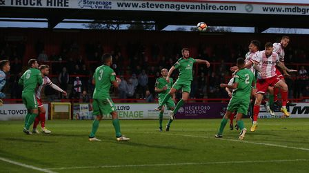 GOAL! Jonathan Smith gets in between players to head home a Martin corner. Picture: Danny Loo