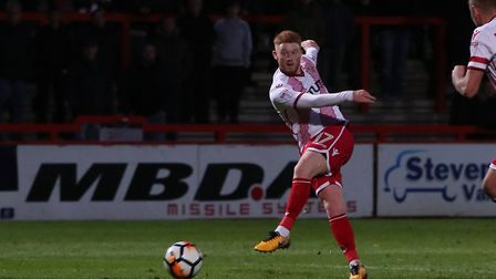 Dale Gorman volleys towards goal and Matt Godden deflects it in to complete his hat trick. Picture:
