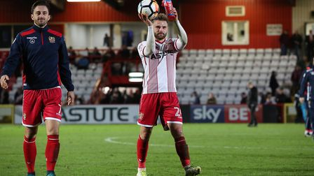 Matt Godden with the match ball claps the fans after the final whistle. Picture: Danny Loo