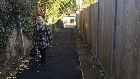 Liz Whitelock using the newly-repaved path between Milestone Road and Bedford Road in Hitchin. Pictu