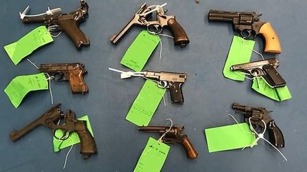 Pistols include a Luger, Mauser, Browning, Walther PPK and bottom centre an antique Pinfire revolver