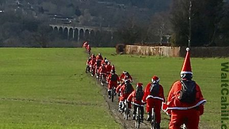A song of 60 Santas. Picture WaltCahill.com