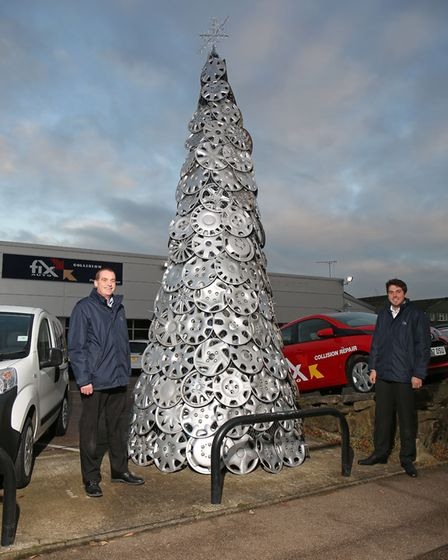 Fix Auto operations manager Richard Harrington and Christmas tree designer Samuel Gilbert with the t