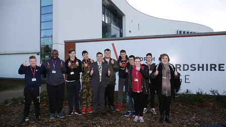 North Herts College principal Kit Davies and students gather to celebrate their good Ofsted inspecti
