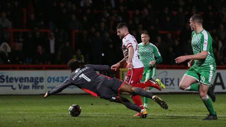 Danny Newton secured Stevenage's passage to round three of the FA Cup with two goals against Swindon