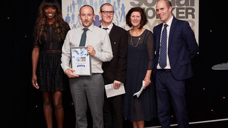 Jason Sedgman from Central Beds Council receives his award from Lorraine Pascale, Alex Smith and Lyn