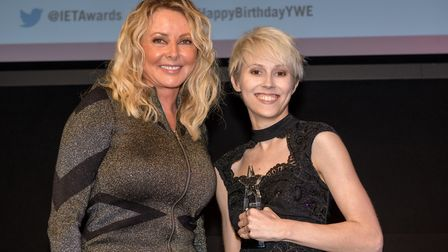 Celebrity Carol Vorderman, host of the IET Young Woman Engineer of the Year Awards, with award-winni