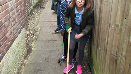 Pupils from Peartree Spring Primary School cleaning up the alleyway they use on their way to school.