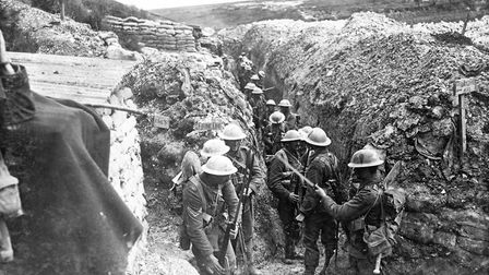Men from the 1st Lancashire Fusiliers fixing bayonets at zero hour on the first day of the Battle of