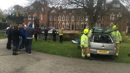 Cutting open a car as part of the road safety demonstration at Princess Helena College near Hitchin.