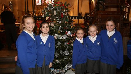 Some members of St Andrews School choir with their tree at the Hitchin Christmas Tree Festival in Ho