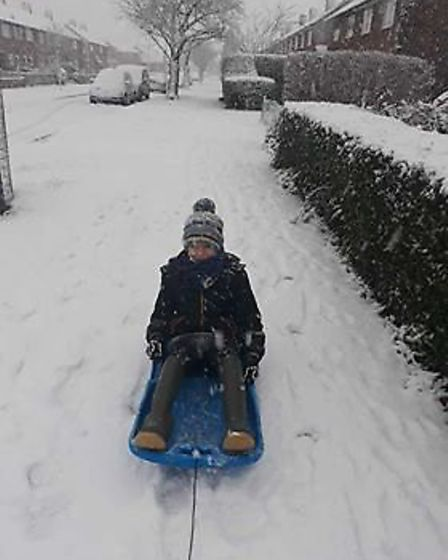 Mark Gray has a go at sledging. Picture: Joanna Gray