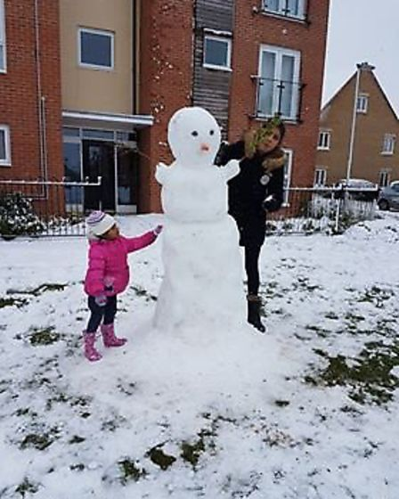 Kush Shergill sent in pictures of her family with the snowman they built...Picture: Kush Shergill