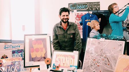 Dan Bramall, The Scribbler, with some of his work at the Hitchin Creative Fair. Picture: Samantha Ha
