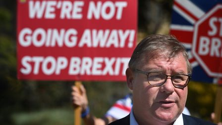 Conservative MP Mark Francois surrounded by anti-Brexit campaigners as he defends the government pro