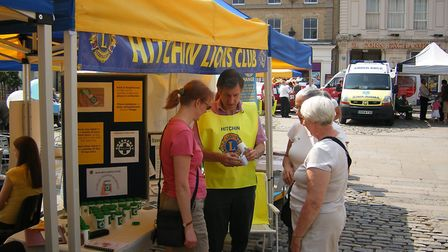 Handing out the Message in a Bottle equipment in Hitchin's Market Place. Picture: Hitchin Lions Club