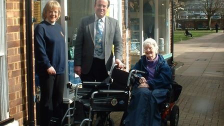 The Lions-donated wheelchair for Shopmobility is accepted by town centre manager Keith Hoskins. Pict