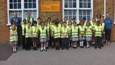 Children from Wilshere-Dacre Junior Academy wearing hi-vis jackets presented by Hitchin Lions. Pictu