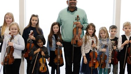 Cuban violinist Omar Puente with young members of Hitchin Violin School at Westmill Community Centre