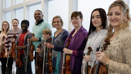 Cuban violinist Omar Puente with Caroline Owen, far right, and members of Hitchin Violin School at W