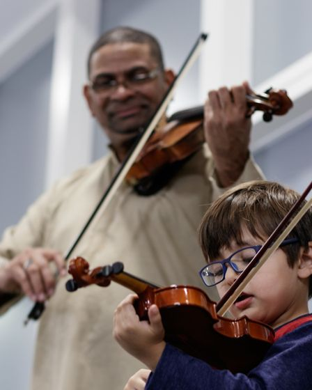 Cuban violinist Omar Puente with three-yerar-old Omar Shaaban, son of Hitchin Violin School's Caroli