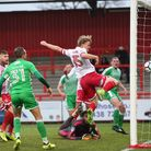 Alex Samuel heads in at the back post to open the scoring in the FA Cup game against Swindon Town. P