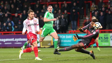 Matt Godden races through to double Stevenage's lead in the FA Cup game against Swindon Town. Pictur