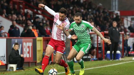 Chris Whelpdale takes on a defender in the FA Cup game against Swindon Town. Picture: Danny Loo