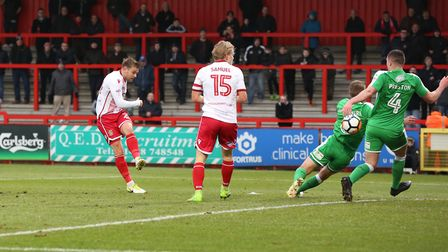 Matt Godden shoots at goal but sees it blocked in the FA Cup game against Swindon Town. Picture: Dan